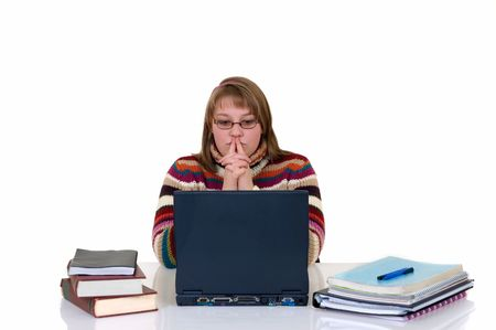 doctrine: Teenager student doing homework with laptop and books on desk, with background, reflective surface