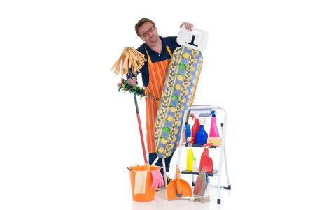 houseman: Houseman with ironing-board and ladder with cleaning products for daily household.  Stock Photo