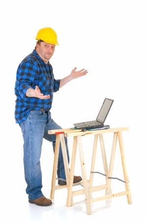slovenly: Carpenter at work with laptop, white background, reflective surface, studio shot
