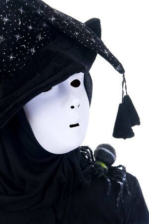 Halloween, fun and creepy, witches hat and white mask on white background  photo