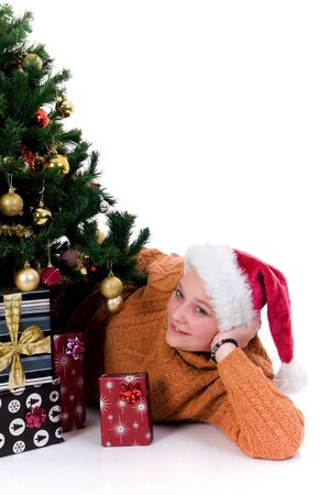 Happy girl by the Christmas tree on white background photo