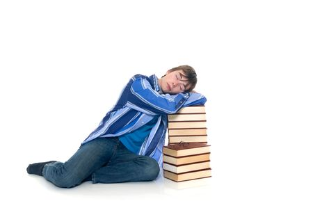doctrine: Teenager schoolboy with books on white background