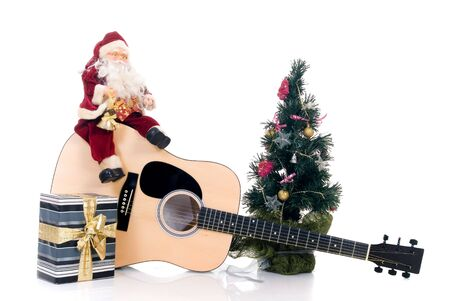 Christmastree with Santa Claus sitting on guitar with present, isolated on white background Stock Photo - 3582561