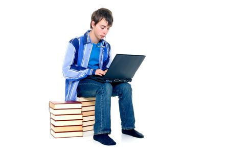 doctrine: Teenager schoolboy with laptop books on white background