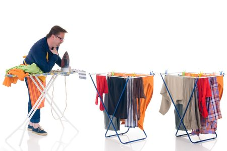 houseman: Houseman doing ironing, clothesline with washed clothing, daily household.