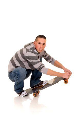 blushing: Handsome happy smiling blushing skaterboy dressed in jeans, studio shot