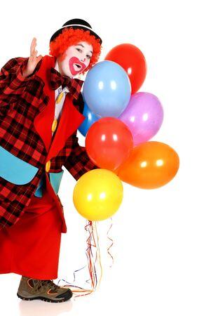 Happy smiling female clown, colorfull dressed, studio shot on white background photo