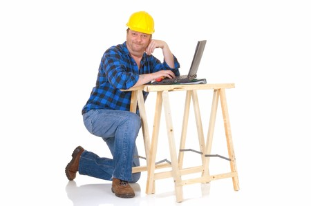slovenly: Carpenter at work with laptop on white background, reflective surface, studio shot
