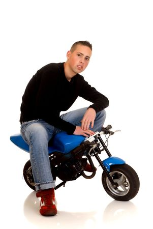 showoff: Youngster show off with his pocket-bike, studio shot on white background