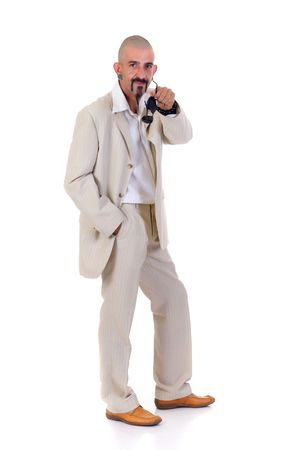 gigolo: Portrait of alternative man with earrings and sunglasses, studio shot