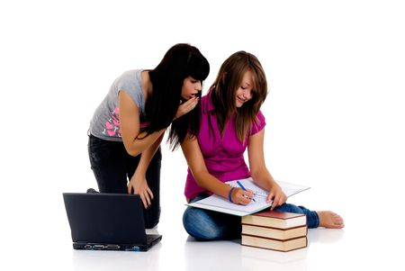 encyclopedia: Teenager girls studying with computer and books on white background