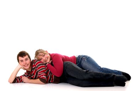 Two casual dressed teenagers, teenage man and woman in love, studio shot, reflective surface photo