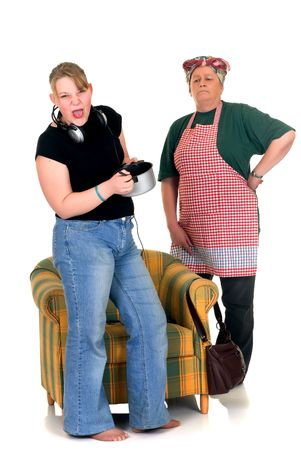 fussy: Middle aged pensive housewife with fussy eating teenager daughter