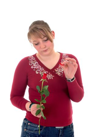 Casual dressed teenager, holding rose flower . studio shot. photo