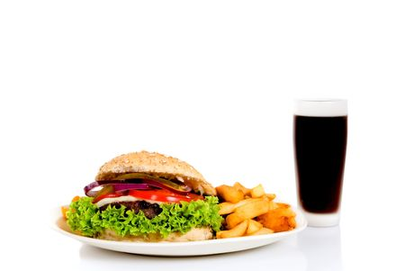 Hamburger with salad, pickle, onions, tomato and French fries.  Studio shot. Stock Photo - 4966155