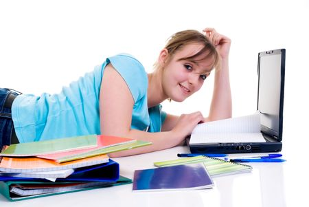 doctrine: Teenager schoolgirl with laptop on white background