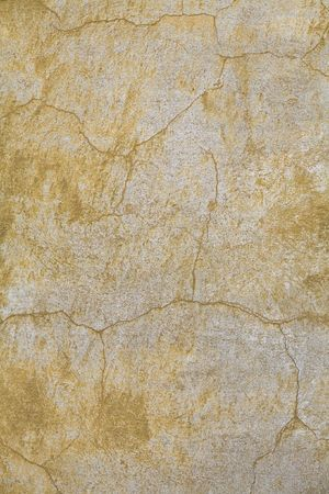concrete surface finishing: faded yellow plaster