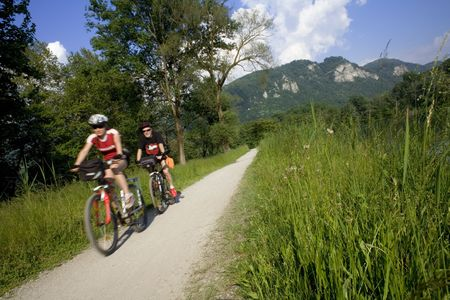 couple biking in the country photo