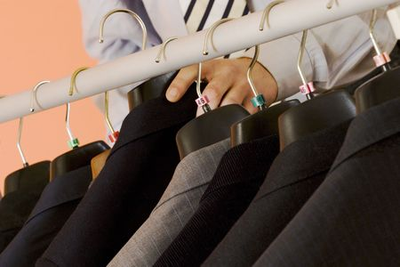 formal dressing: the man is chosing the right suit for his working day! Stock Photo