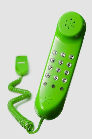touchtone: floating green telephone isolated on white background Stock Photo