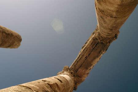 colonization: ancient roman columns against a blue sky Stock Photo