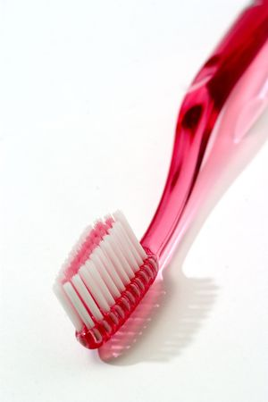 Pink toothbrush isolated against white photo