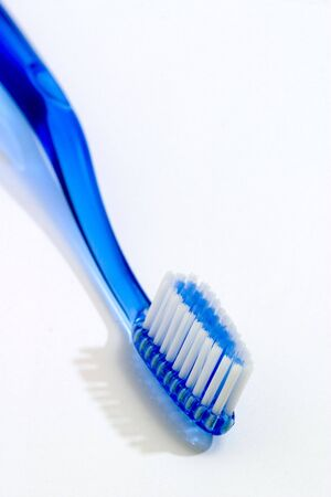 Blue toothbrush isolated against white photo