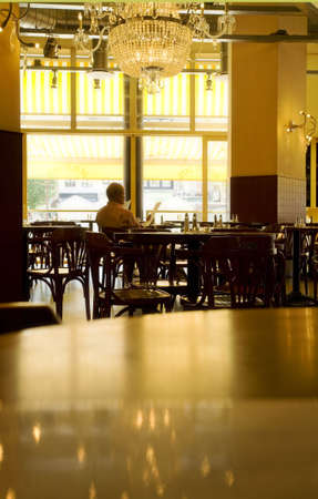caf: man sitting alone in a pub and reading the menu Stock Photo