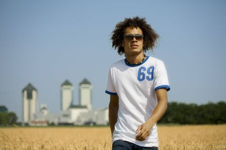 cool guy walking in a cornfield Stock Photo - 446257