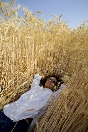cool guy sitting in a cornfield playing guitar Stock Photo - 463132