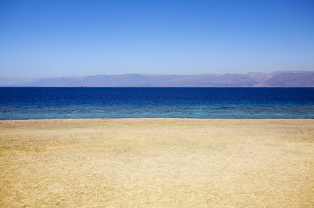 sun drenched: empty beach in a sunny day