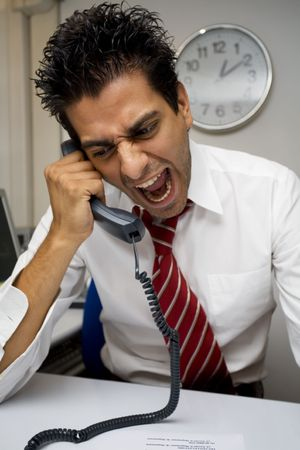 preoccupation: angry businessman screaming on the phone