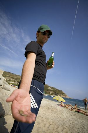 drinking a fresh, cold beer on a summer beach!! Stock Photo - 509959