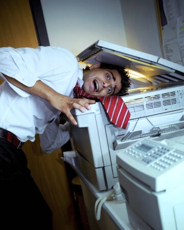 rude: young business in trouble with the copy machine
