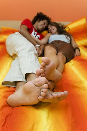 young couple playing on the bed photo