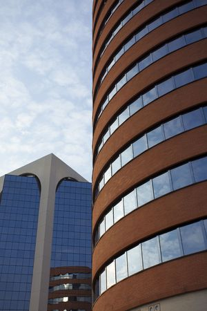 headquaters: Shot of a corporate office building on a cloudy day. Stock Photo