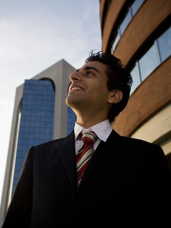successful businessman staring at the sky and smiling photo