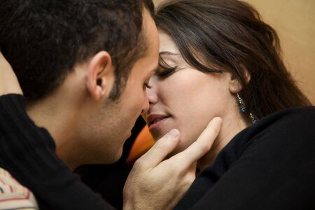 portrait of a young couple kissing and hugging Stock Photo