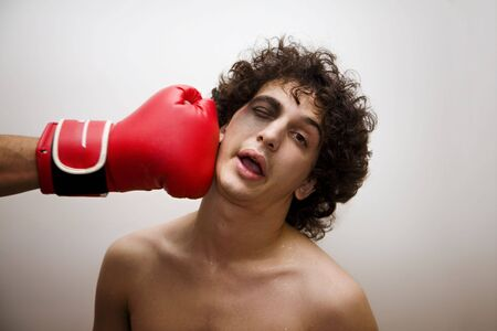 hitting: born to be a boxer? I dont think so.... Stock Photo