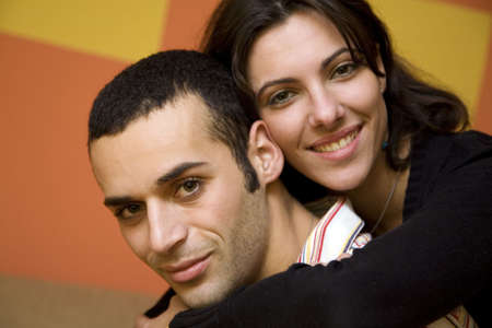 man and woman smiling and holding each other photo
