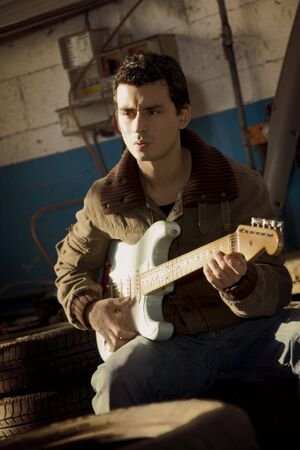 reverb: cool guy playing blues in a garage Stock Photo