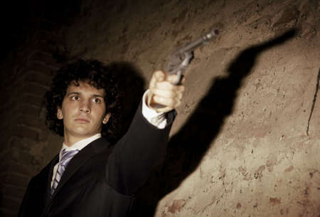 Murder in action: the gangster is gonna push the trigger! Stock Photo - 679978
