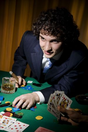 A stroke of luck playing poker. The guy cleaned all out Stock Photo - 684955