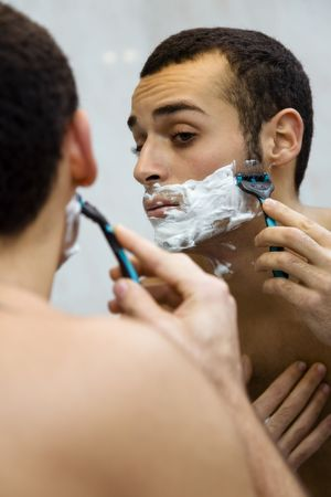 lather: morning routine: a man shaving before going to work