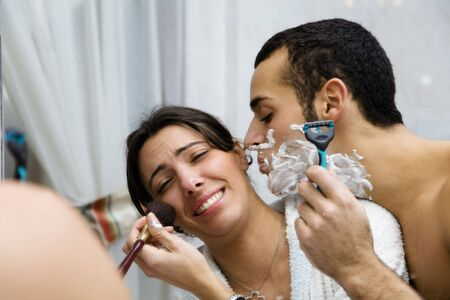 routines: morning routine: the guy shaving and the girl (trying to) apply her make-up