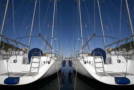 boats anchored in a harbour on a sunny day Stock Photo