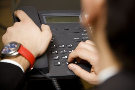 touchtone: young businessman making a phonecall in his office Stock Photo