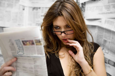 adult magazines: going to the movies: woman checking out movies reviews