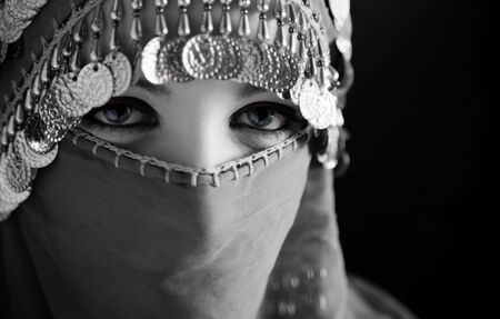 middle eastern culture: belly dancer with traditional veil Stock Photo - 765355