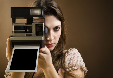 old-fashioned: girl taking a picture with an old  photo